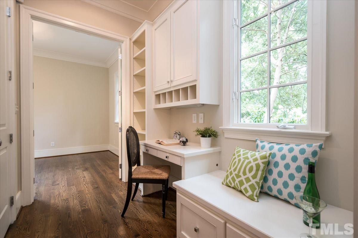 "...leads to large walk-in pantry (not shown), a ""bill desk"", and connects to..."