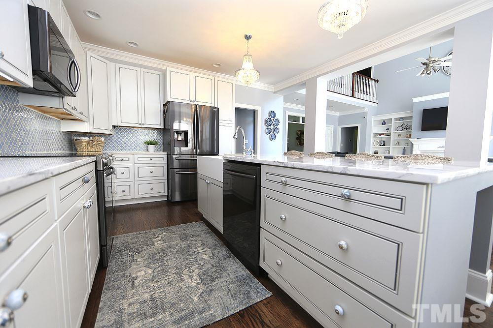 Kitchen w/Hardwoods, Cabinets w/Soft Touch Hardware & Pullout Shelving 2017, Marble Countertops 2017, Farmhouse Sink 2017, Refrigerator, Microwave, Dishwasher & Range 2017, Breakfast Bar, Modern Lighting.