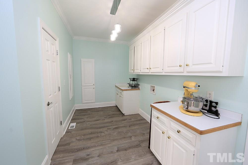 Laundry Room w/Counterspace, Cabinets, Lighting.