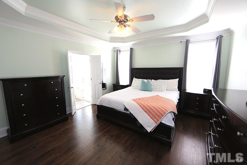Master Bedroom w/Hardwoods, Trey Ceiling, Ceiling Fan, Windows, Walk-in Closet.