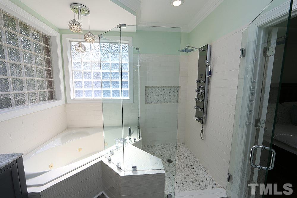 Fully Remodeled Master Bath w/Tile, Large Shower, Separate garden Tub, Tempered Glass, Cabinets.