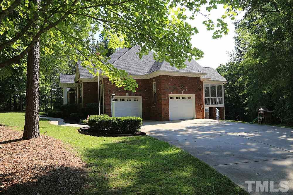 2 Car Side Entry Garage for All-Brick Home w/Spacious Driveway and Easy Sidewalk Access.