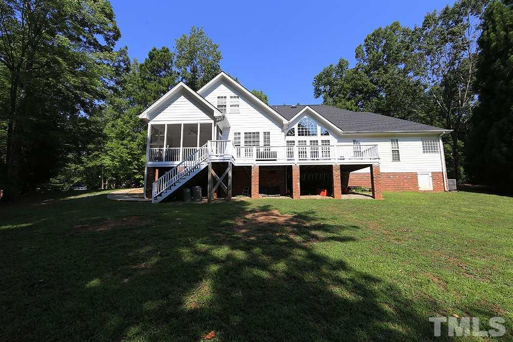 Exterior Back of Home, Extra Storage Under Deck, Easy Access to Screened Porch, Open Back Yard Space.