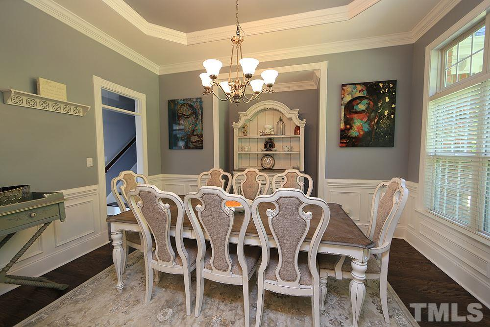 Dining Room w/Trey Ceiling, Chandelier, Hardwoods and Large Window.