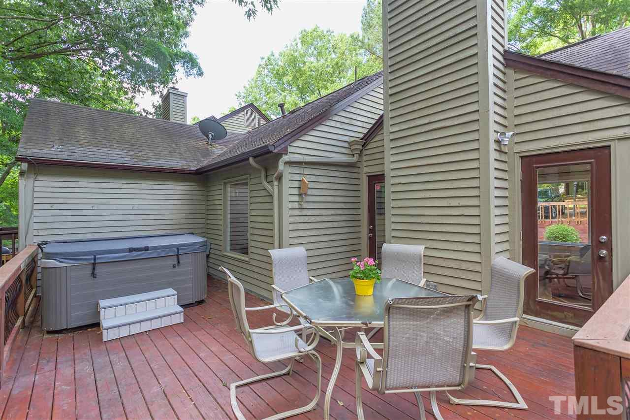 Wonderful deck with iron railings and plenty of space to create your own backyard oasis.