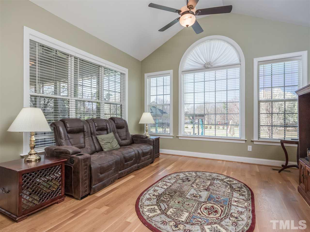 The cathedral ceiling and the view out the palladium window make this room a family favorite!  Watch closley and you may see deer jumping the fence.
