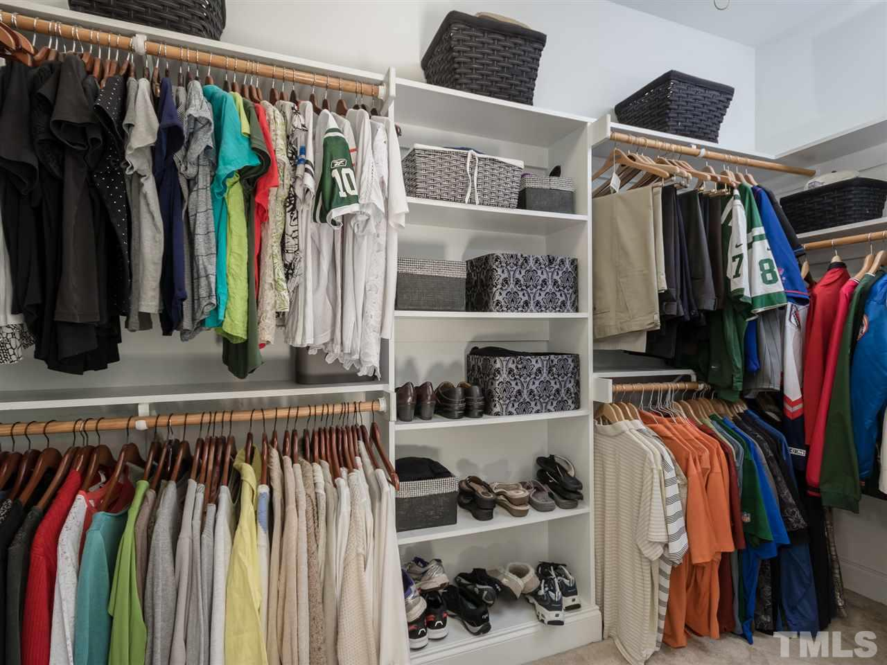 Huge walk-in closet detailed with wooden shelves. Watch for the hidden pulldown stairs to additional unfinished storage.