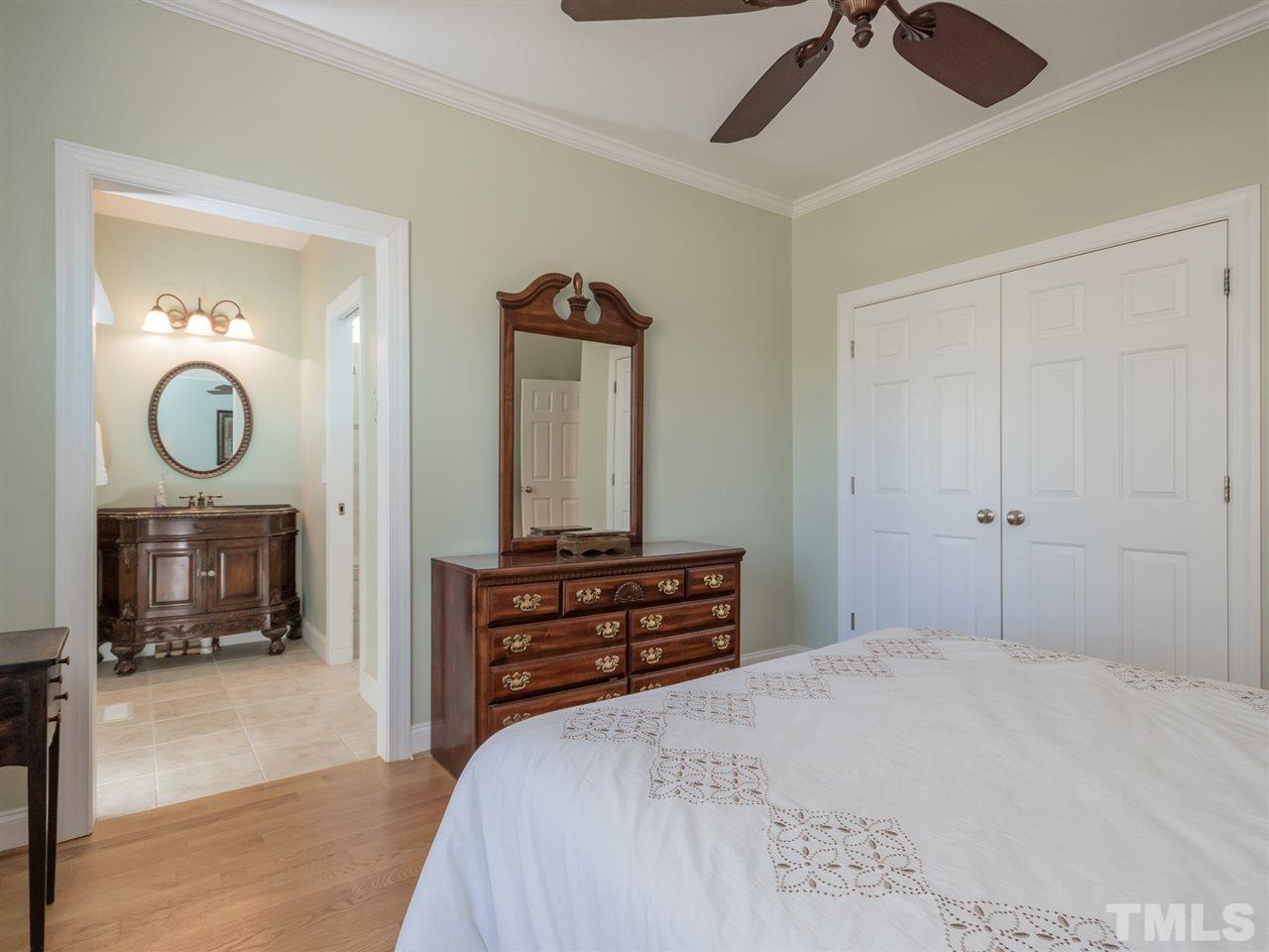 Two guest bedrooms on the main level with compartmented bath in-between, each with their own vanity area.