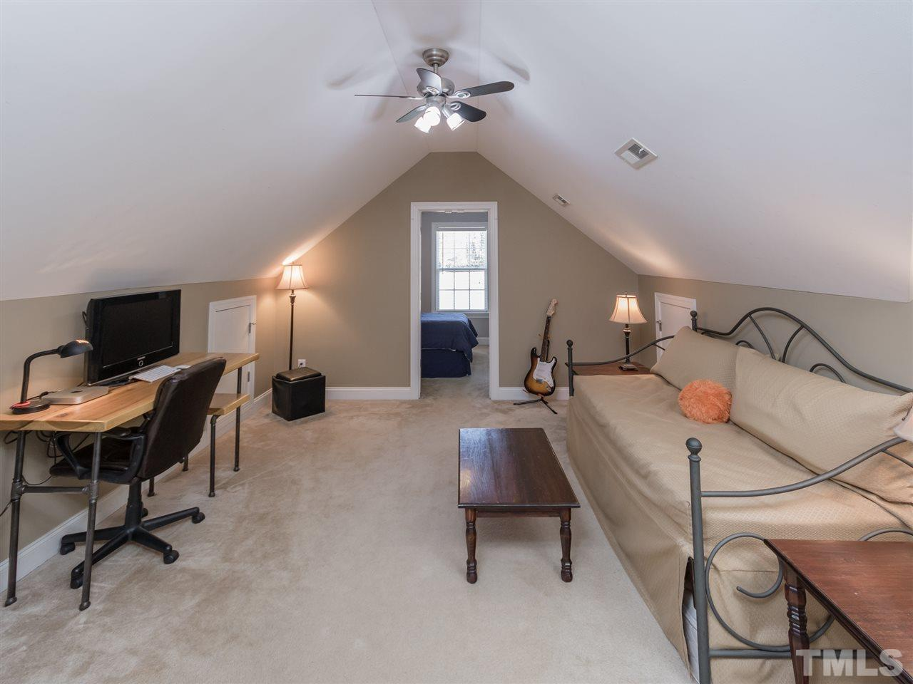 Peak through the versatile bonus room and get a glimpse of the private office/flex room.