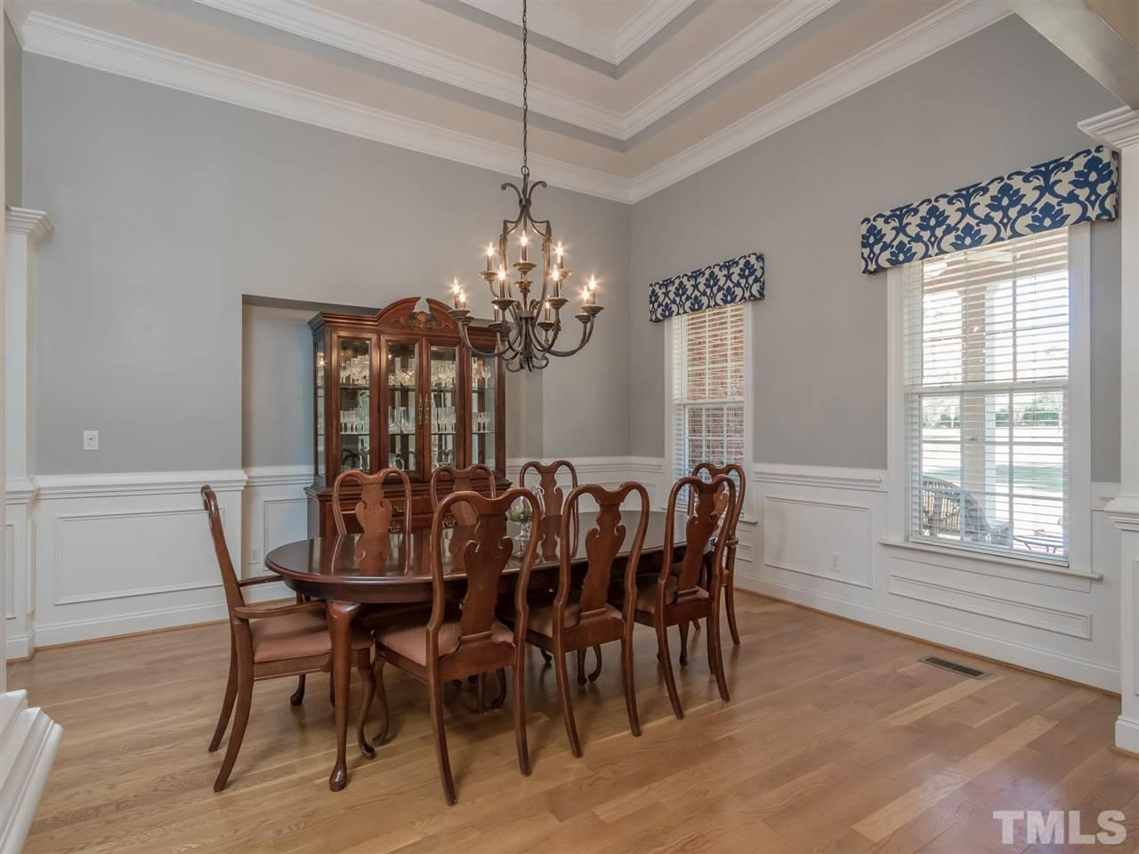 Dramatic 14' ceilings and a full wall of bowed windows enhance this awesome gathering room.