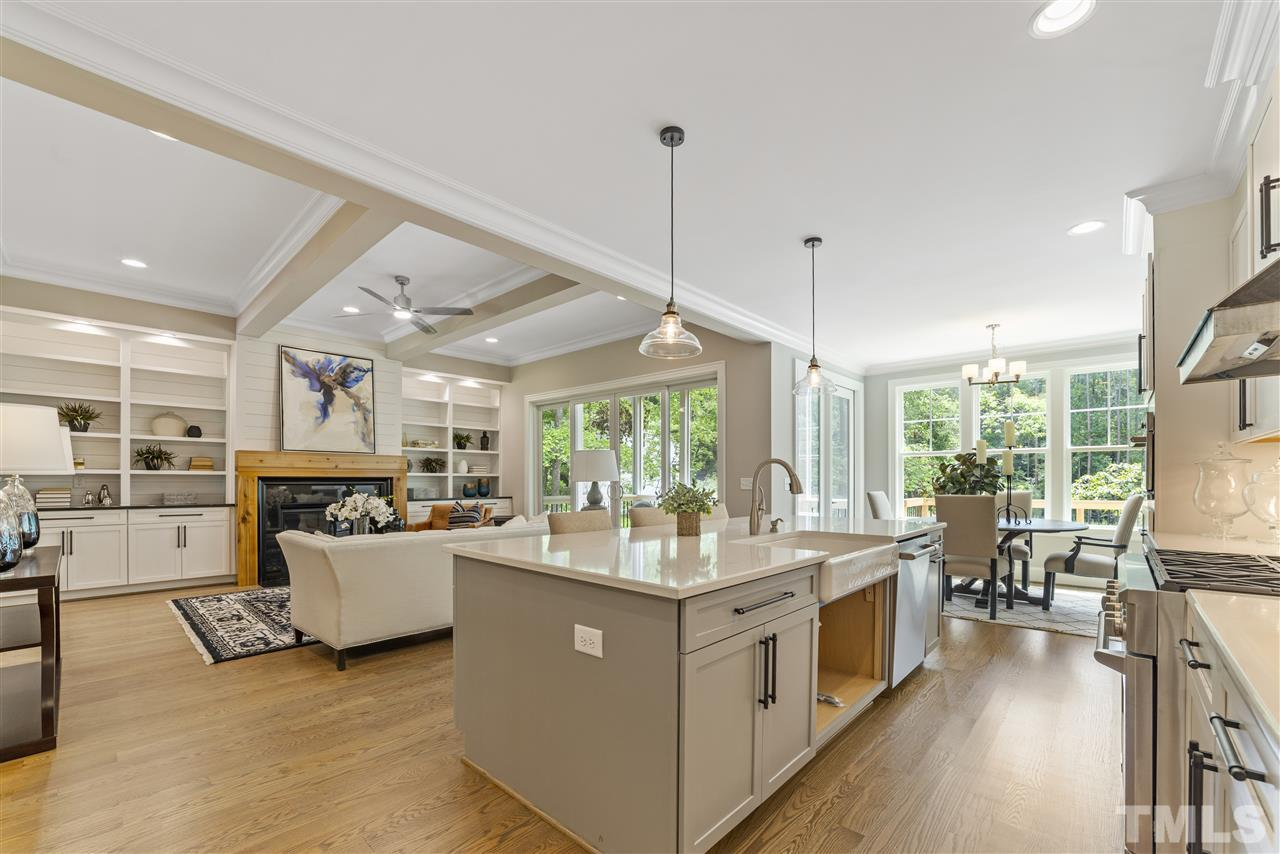 The huge island is a great gathering place as well as works space.  There is a large porcelain farm sink (builder is waiting on cabinet doors to arrive for beneath sink and will be installed asap).  There are pendants lights above the island as well.