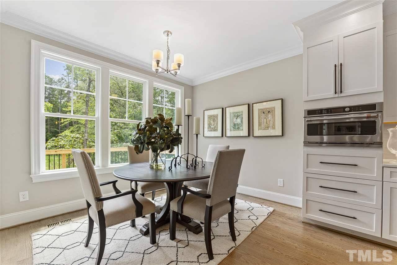 The breakfast room is light-filled.  There is a door to the screened porch in addition to the sliders in the family room.  The cabinet configuration in the home offers a nice blend of drawers and cabinets.