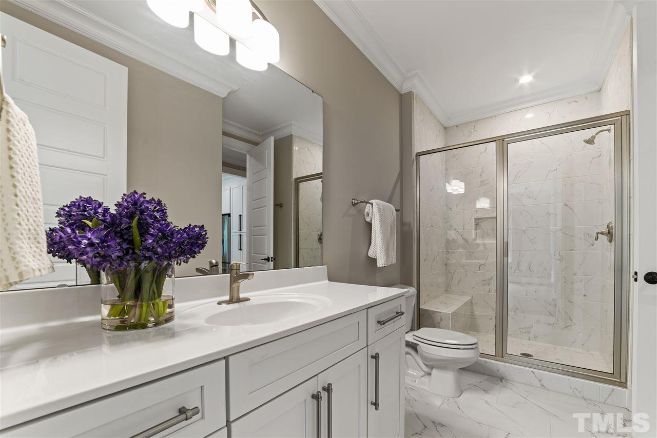 The main floor bathroom has a walk in shower and large vanity.