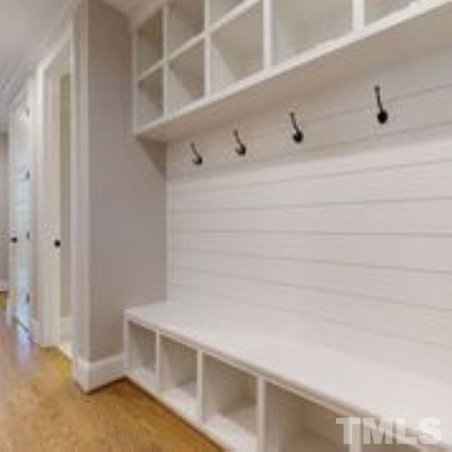 The drop zone in the home is amazing with cubbies to the ceiling, hooks and bench!