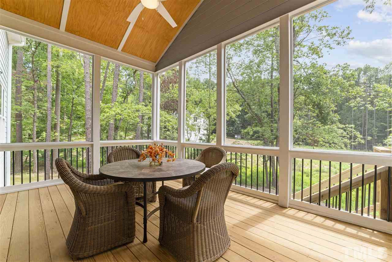 The screened porch has a vaulted ceiling with bead board and a fan.