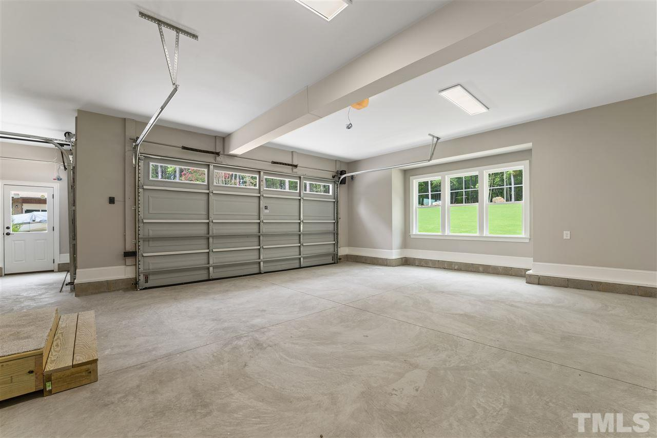 There is an oversized 2 car garage plus a large one car with plenty of outlets.  Home is roughed in for central vac.