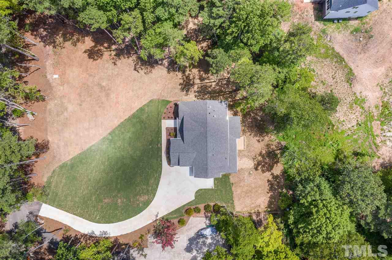 The drone view from above gives you a picture of the home on the lot. A nice blend of trees, grass and natural space.