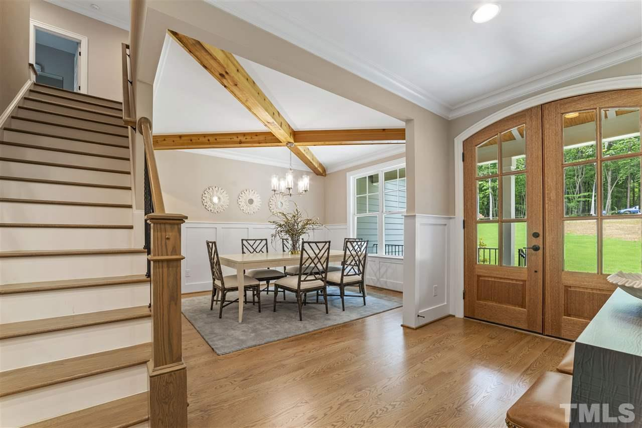 Arched, double wood doors greet you. Enter and you will immediately notice the attention to detail that has been taken in this home with carefully crafted millwork, cove moldings, shiplap, gorgeous hardwoods, open floor plan...so many wonderful features.