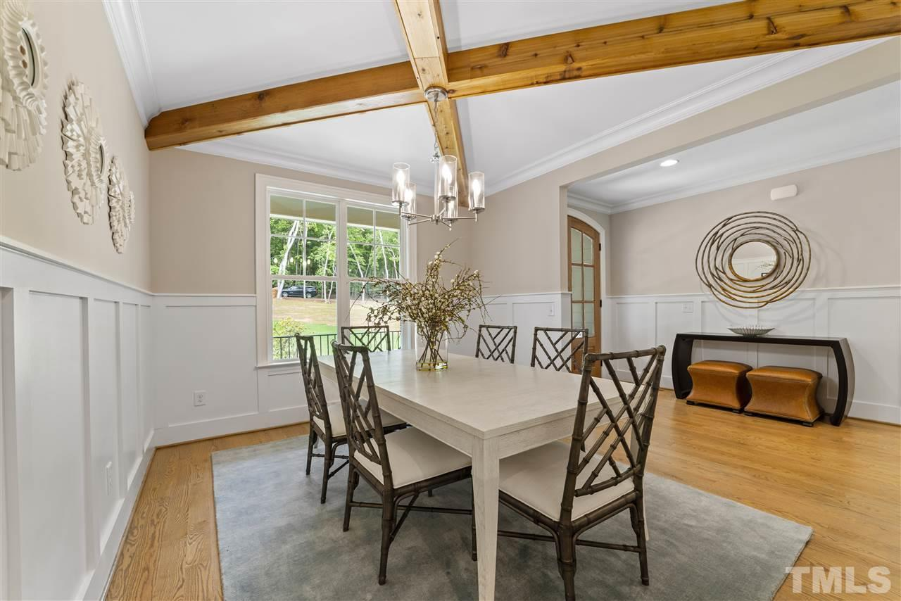 Not only is there a craftsman style wainscoting but architectural style wood beams cross the ceiling for a dramatic effect.