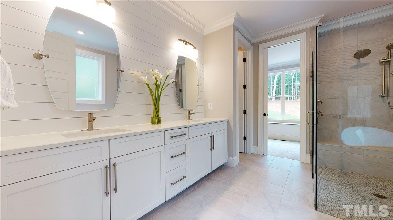 Ship Lap highlights the wall behind the mirrors in the master bath.  There is plenty of cabinet space.  The counters are quartz.  The bath has a true spa-like feel, with a separate water closet.