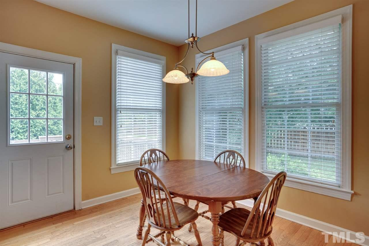 In addition to the large kitchen island seating there is a nice breakfast area that looks out onto the deck and back yard.