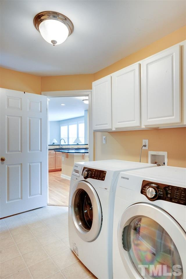 The laundry is located off the kitchen and provides access to the garage.