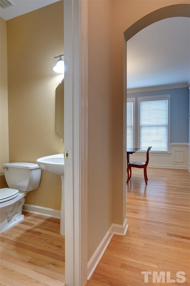 The main level half bath is located between the kitchen and the dining room.
