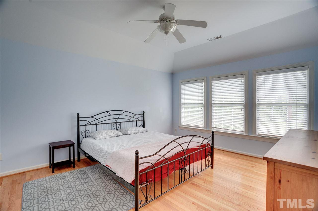 The spacious master bedroom with trey ceilings is your respite from the business of life.
