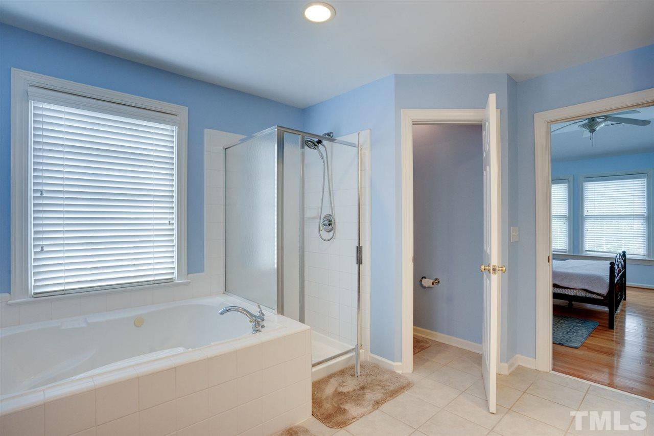 The master bath is very spacious, with linen closet and water closet (room for the toilet), soaking tub, separate shower and double vanity.