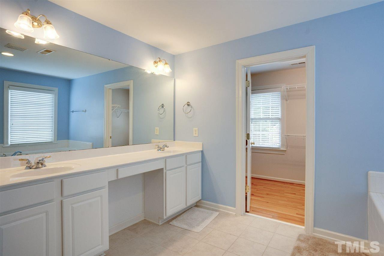 Walk through the master bathroom into the large master walk in closet. Lots for room for you and yours.