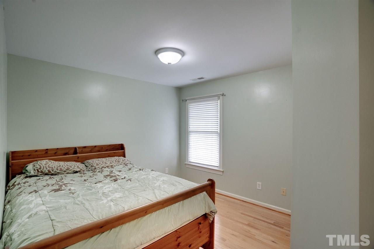 Spacious bedroom on the back of the house with great storage and natural light.