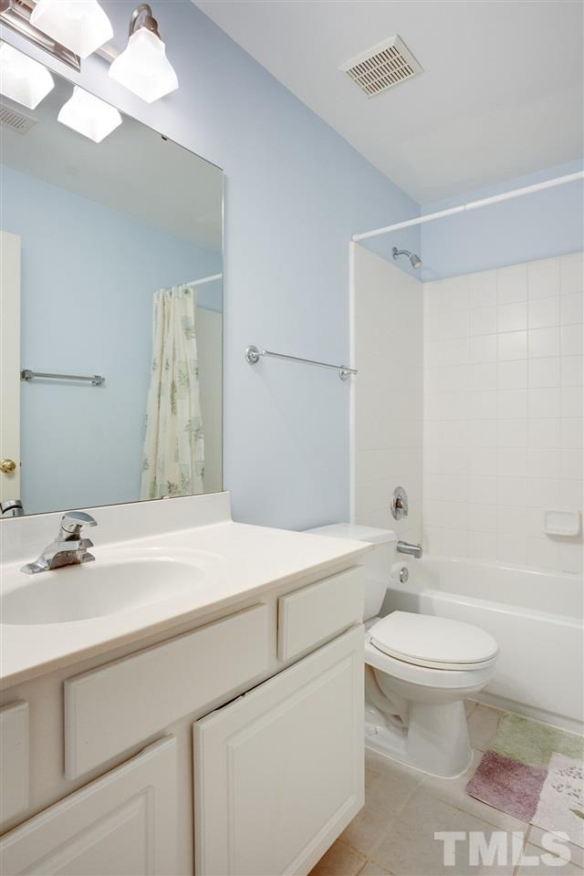 The full bath on the second floor hall is spacious and bright.