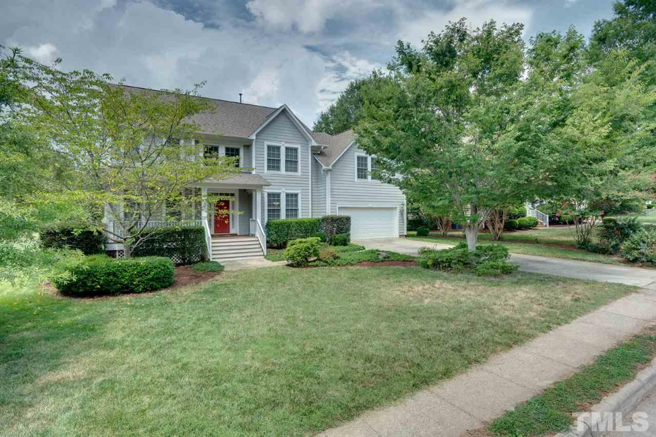 Landscaped front yard, ample parking and great location make this house a winner!