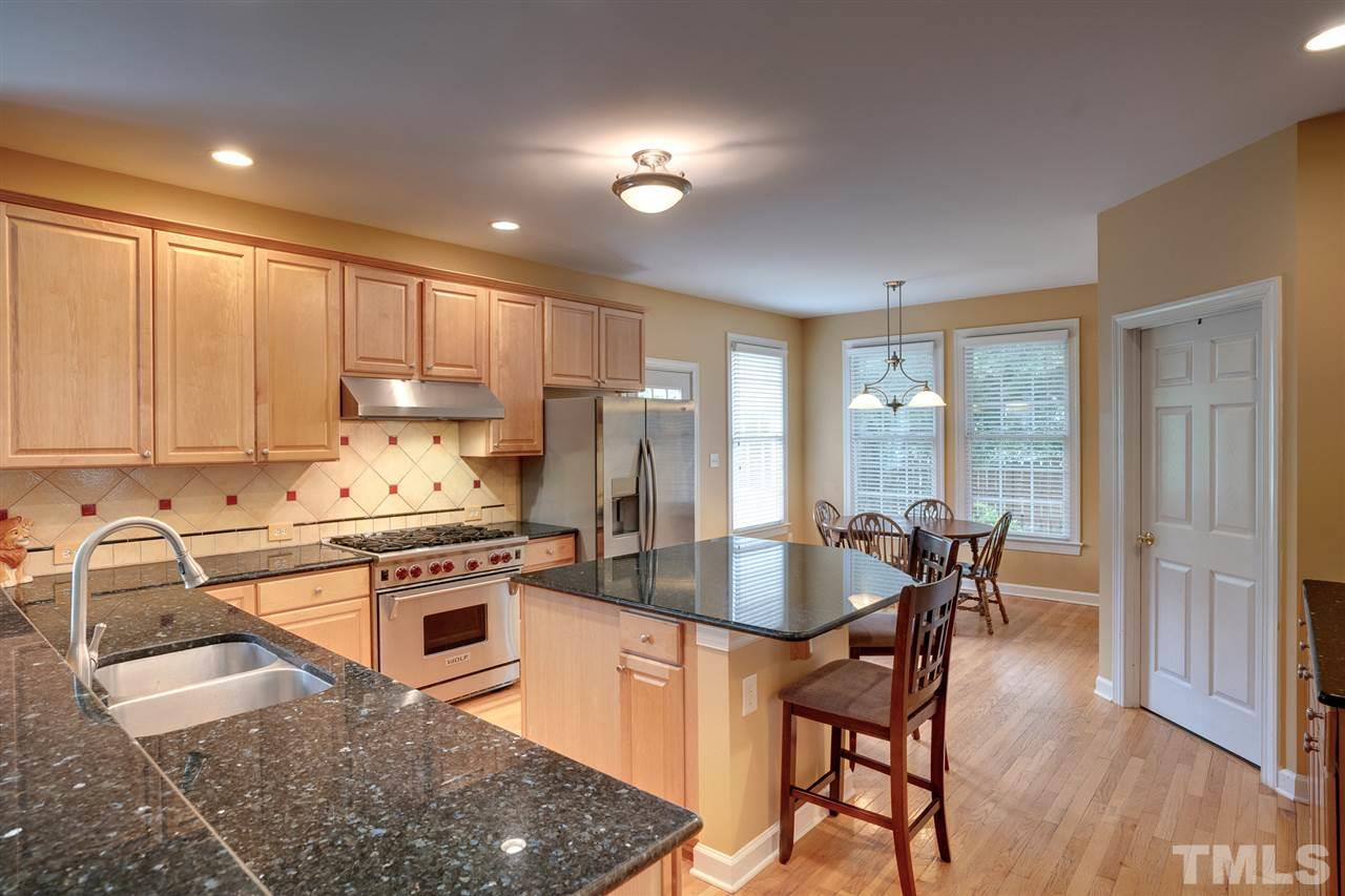 Granite counter tops, 6 burner Wolf gas stove/oven, large island, beautiful cabinets, all with great lighting and layout.