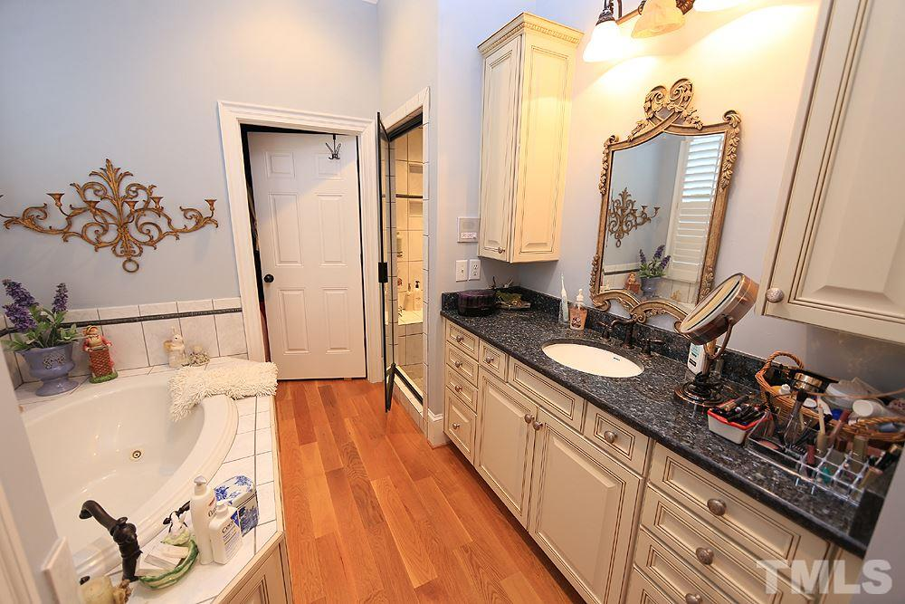 His & Her private master bathroom each with separate water closets.  Her side has bath tub both side access the walk in shower.