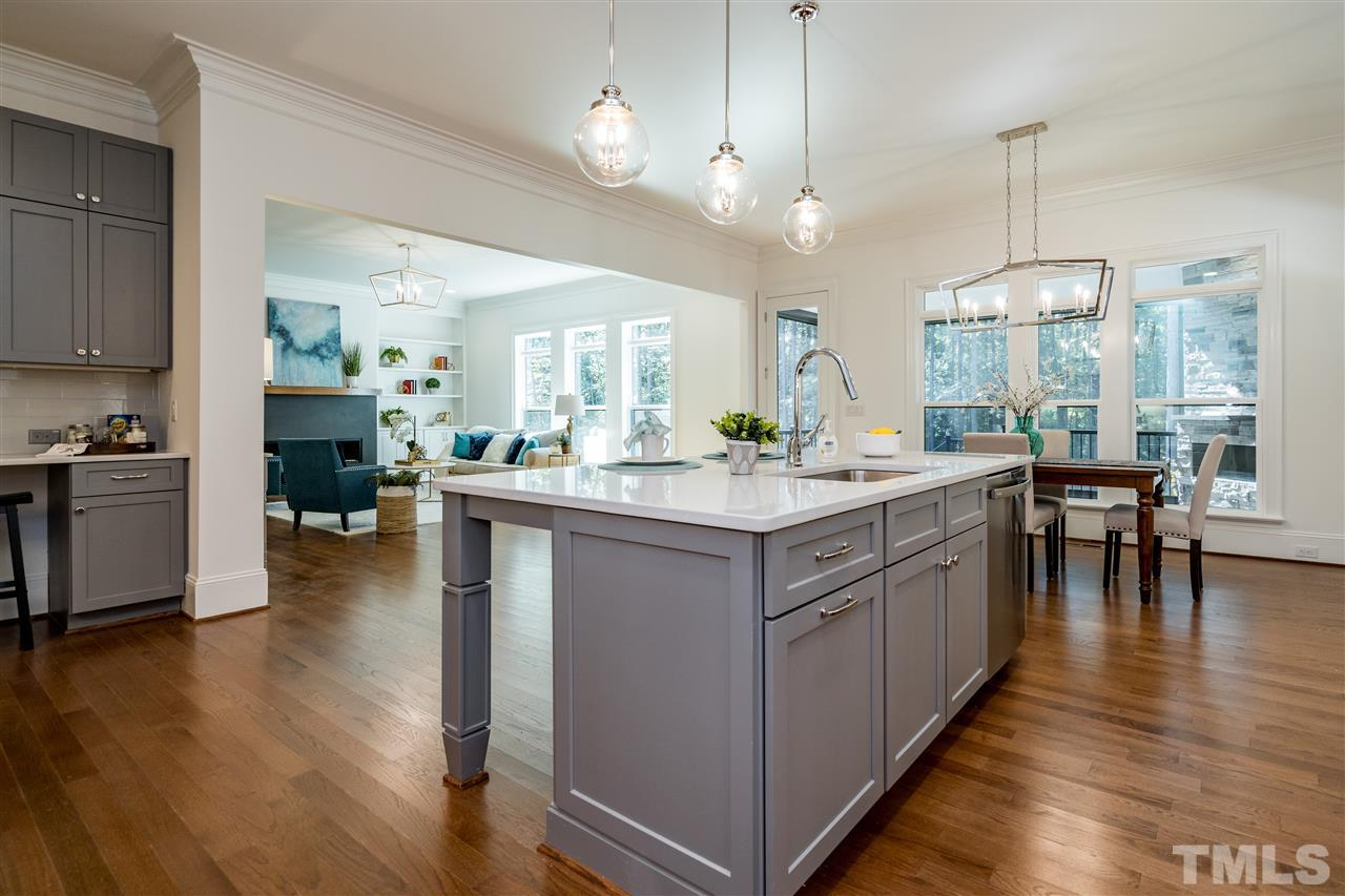 Large windows bring in lots of light into the breakfast area.