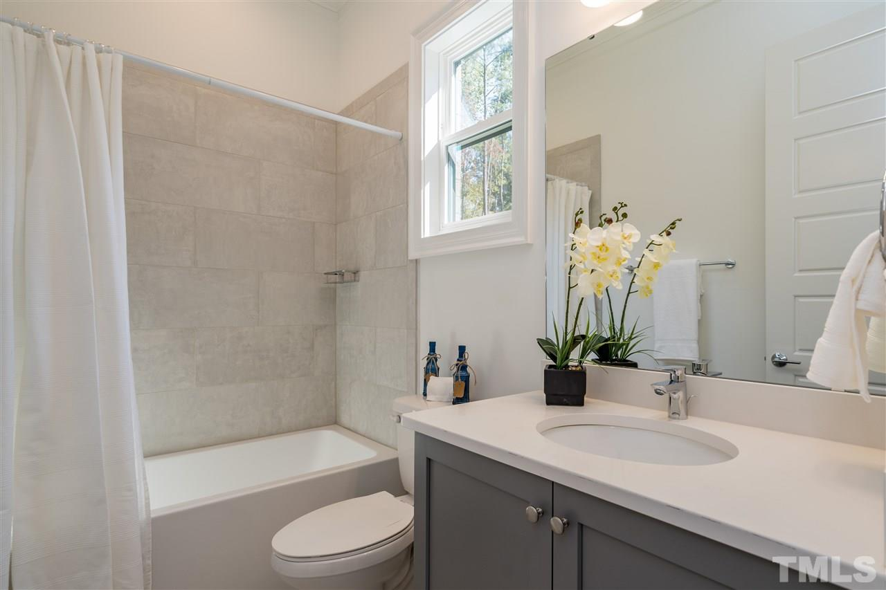 Spacious en-suite bath with separate shower and free-standing tub open to a huge walk-in closet.