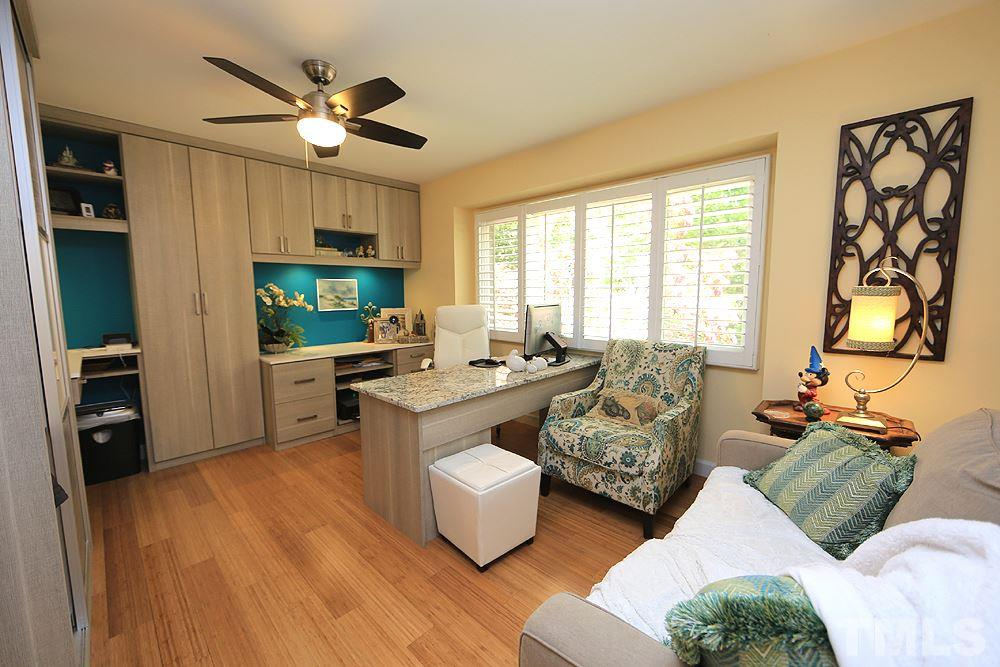 Office completely remodeled and upgraded with shelving and California closet built-ins