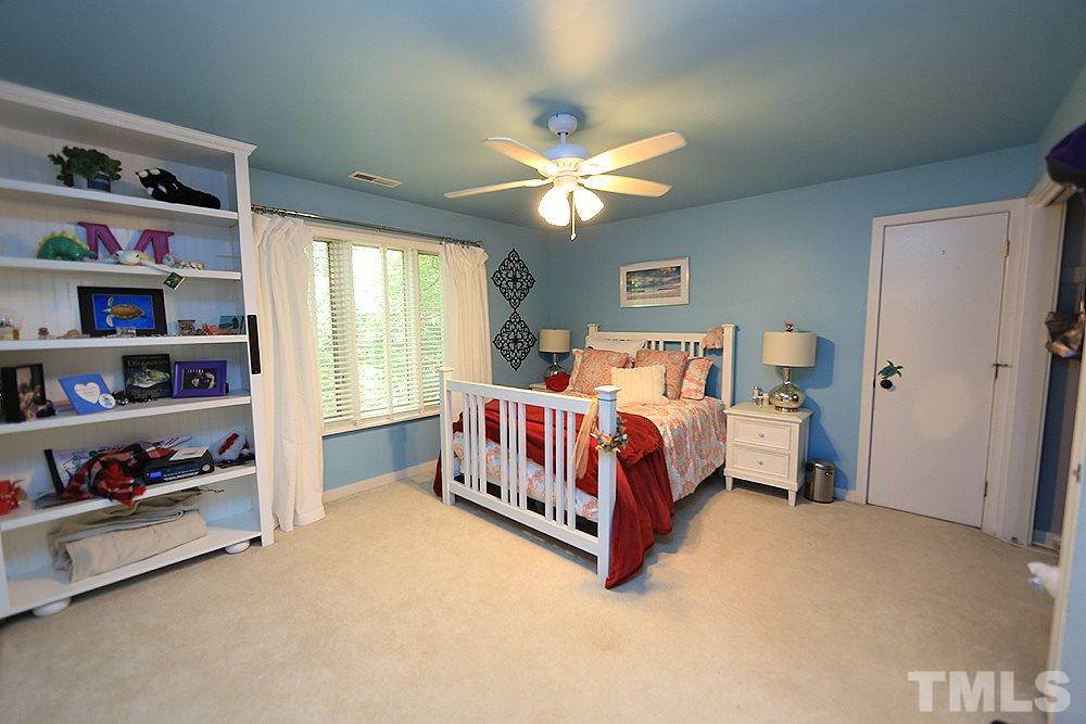 Second level bedroom with large room off of it for storage or a playroom for a little one