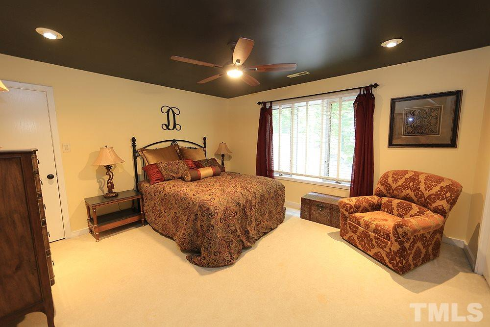 Another bedroom on the second floor that also has a storage closet off of it