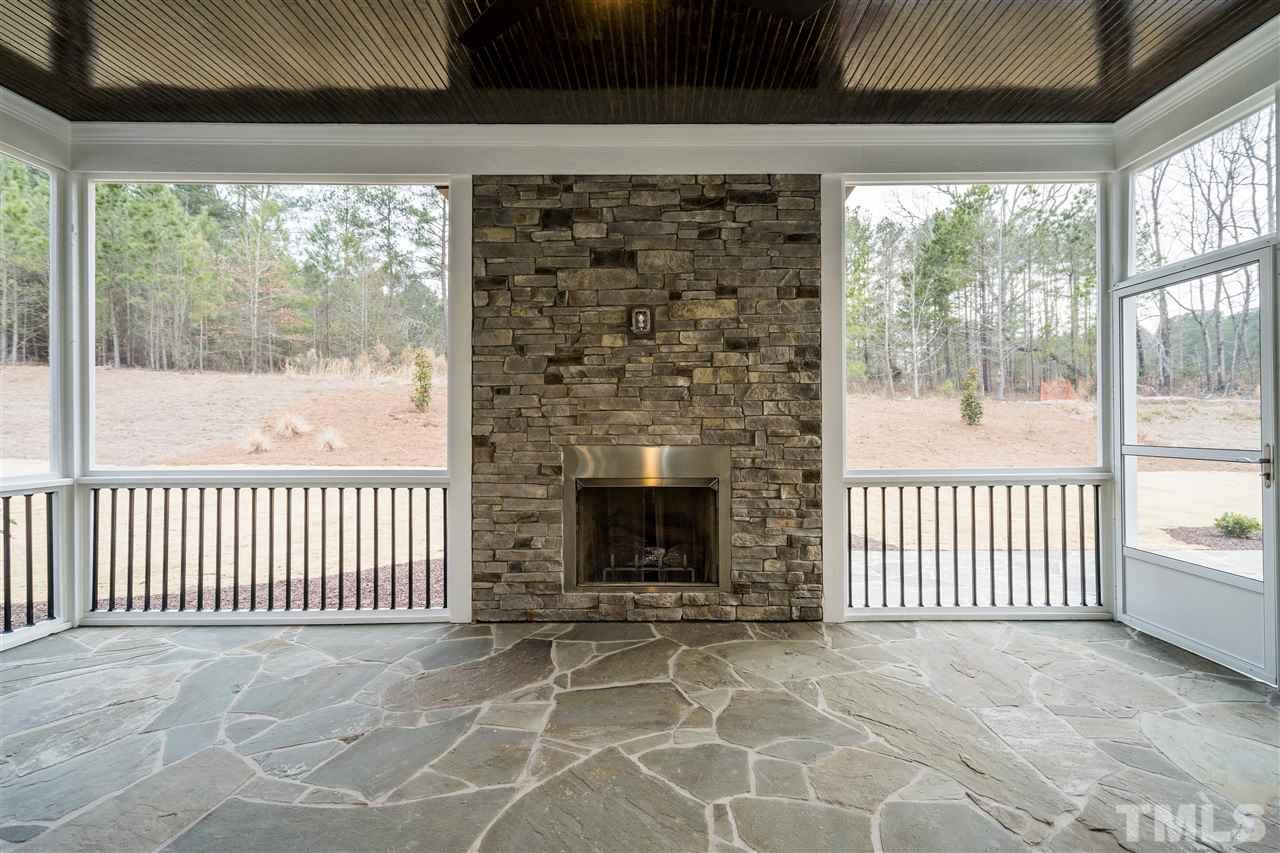 appointed with Stone floor and gas fireplace