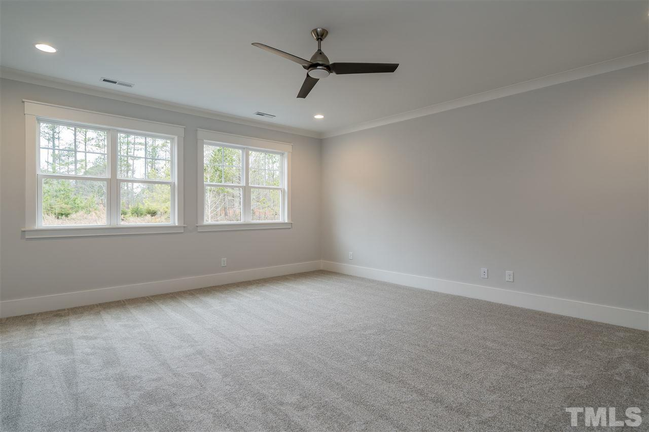 Located upstairs, not over garage, square with large wall space, closet and bath attached.