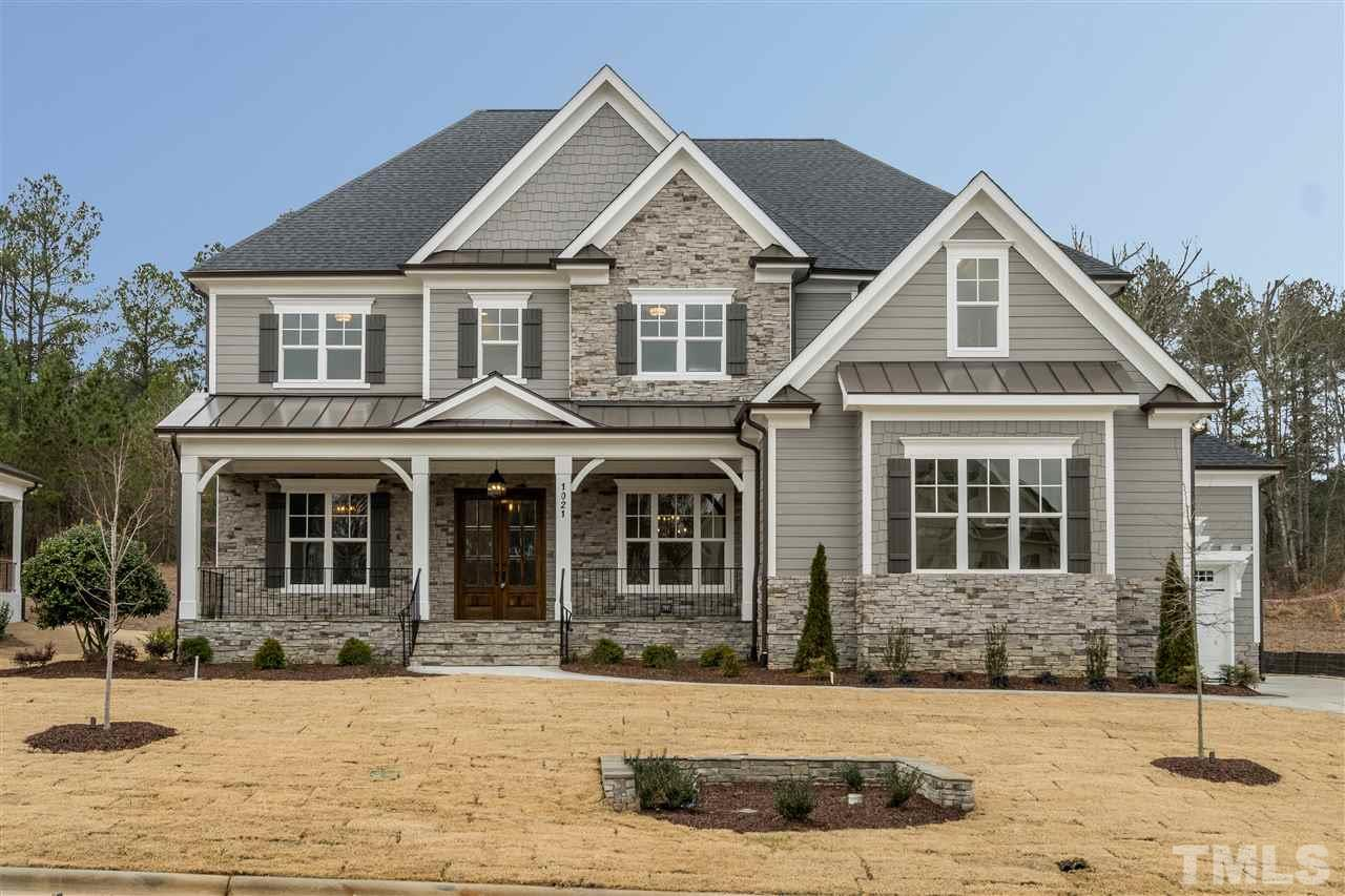 Beautiful Luxury Custom Built Home with Large front porch and stone accents