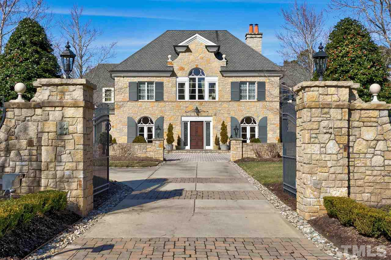 Welcome to this lovely French Chateau. The stone details are reminiscent of a European estate. The grand double automatic gate provides an air of majestic opulence.