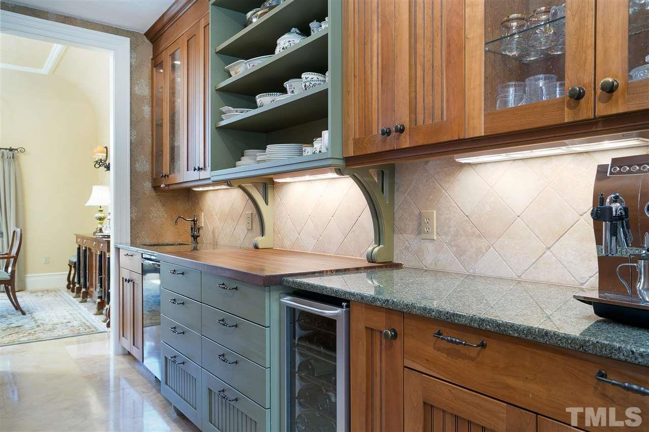 Catering a dinner would be so efficient with this butler's pantry having a second dishwasher, sink, wine refrigerator and ample cabinet and counter space.