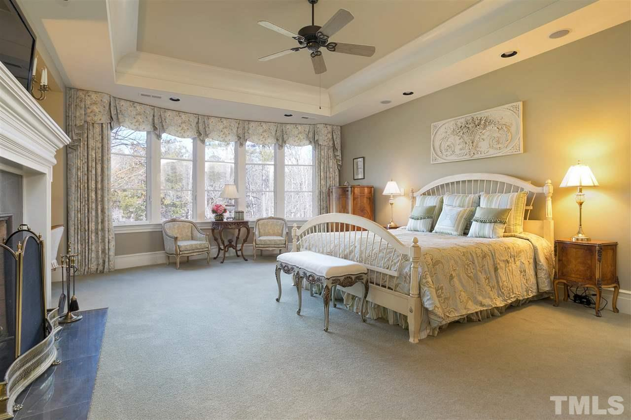 Relax and cozy up next to the masonry fireplace in your master suite or have your morning coffee in the bright window area. The tray ceiling provides for more grand space above.