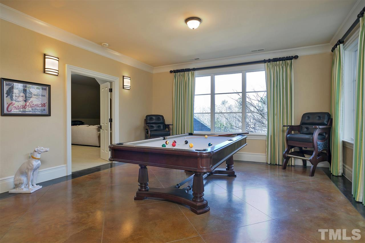 A game of pool anyone? What a fun place to spend time with guests with a billiard room, theater room, bar and bonus room all together.