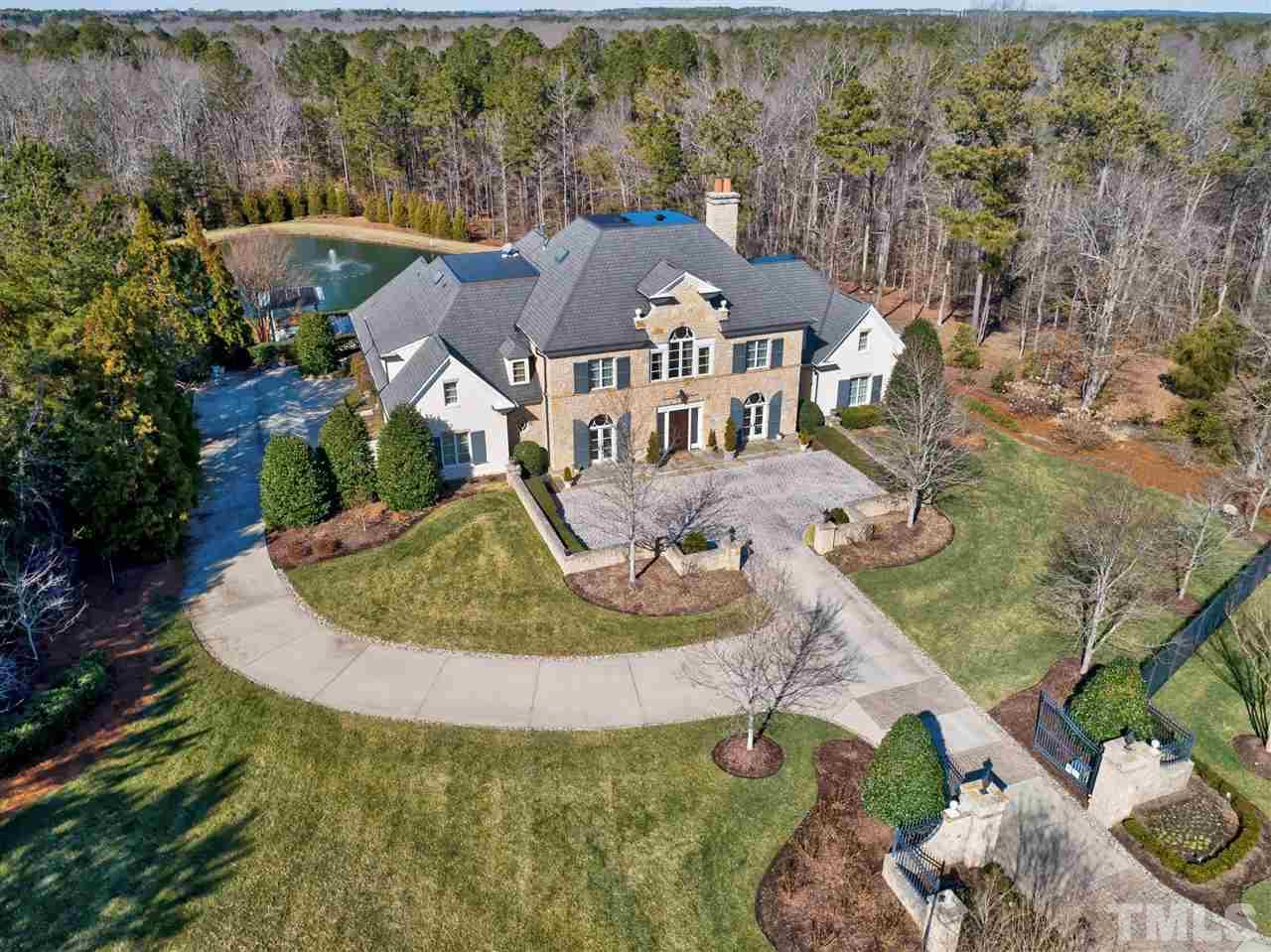 "On nearly 5 acres, most of it fenced, this estate provides a sense of exclusivity and security. To quote the builder, it is the highest quality structure possible"" & virtually soundproof with steel reinforced poured concrete walls, ceilings & floors"