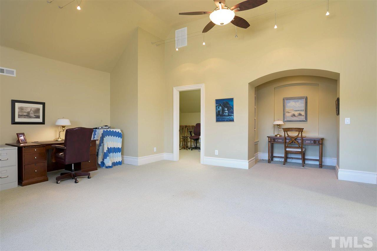 Utilize this third floor flex space however you'd like; as a playroom, private home office, art studio or yoga room. To the left of the room is a large conditioned storage space with loads of shelving. You also have storage in the walk-in attic area.
