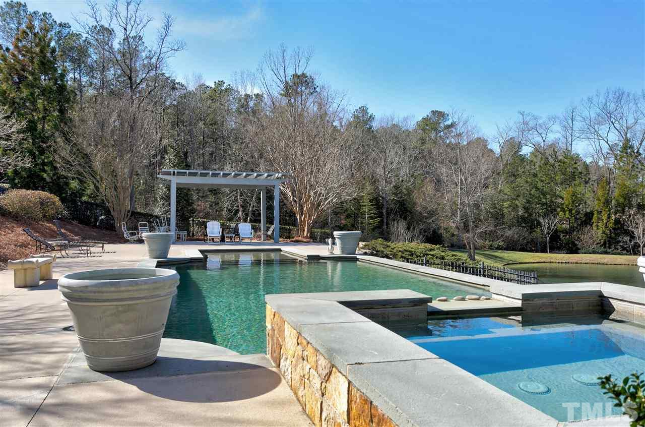 Spend those warm Carolina days around your saltwater pool or relax in the spa with cascading waterfall feature flowing into the pool.